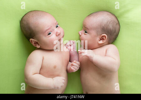 Funny baby infant boys twin brothers - Stock Photo