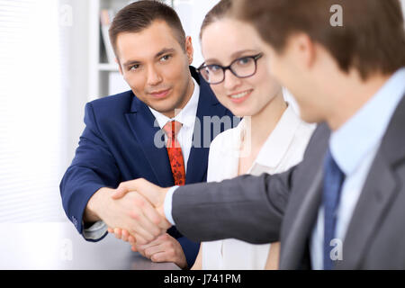 Two business man shaking hands to each other finishing up the meeting - Stock Photo