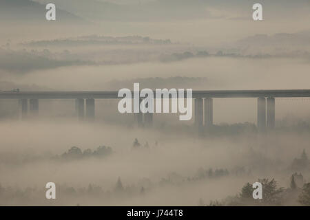 Viaduct on Sunrise with morning mist in mountains of Croatia - Stock Photo