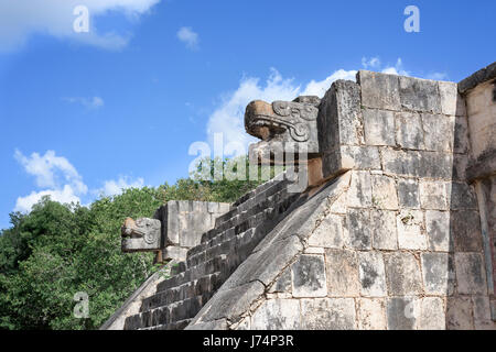 stone jaguar head statue at the Platform of the Eagles and Jaguars in Mayan Ruins of Chichen Itza, Mexico - Stock Photo