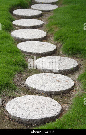 garden stone rock step walkway road street garden stone future round about - Stock Photo