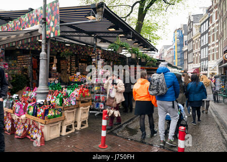 AMSTERDAM, NETHERLANDS - MAY, 13, 2017: The Bloemenmarkt is the world's only floating flower market. Founded in - Stock Photo