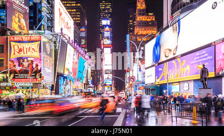 Times Square in New York city at night. - Stock Photo