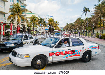 Miami Beach Florida Ocean Drive policeman police car patrol street blocked temporarily pedestrian-only New Year's - Stock Photo
