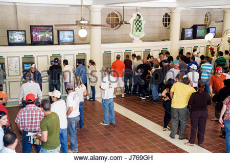 HialeahMiami Florida Hialeah Park quarter horse racing racetrack betting windows bettors gambling - Stock Photo