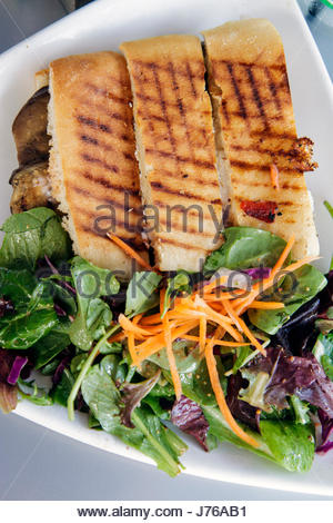 Miami Beach Florida Lincoln Road pedestrian mall alfresco dining restaurant panini sandwich salad plates The Cafe - Stock Photo