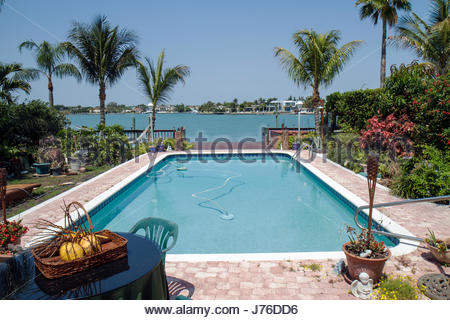 Miami Beach Florida Normandy Shores Biscayne Bay waterfront residential yard swimming pool - Stock Photo