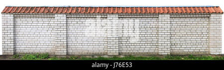 Hard long solid rural fence made from  white  bricks. Red clay tiles on top,  Isolated  panoramic collage from several - Stock Photo