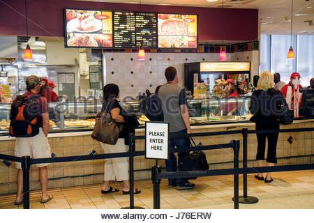 MiamiMiami Florida International Airport MIA MiamiMiami Florida International Airport MIA concourse shopping passengers - Stock Photo