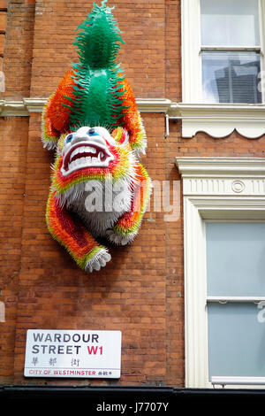 Chinese dragon on side of building at Wardour Street Chinatown London - Stock Photo