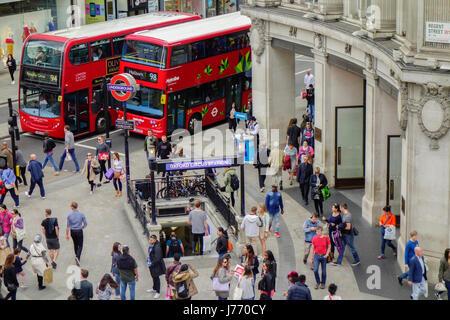 Shoppers shopping on Regent Street, London. - Stock Photo