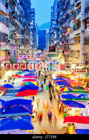 HONG KONG, CHINA - APRIL 24: This is a night view of Fa Yuen street market a popular local market in in the Mong - Stock Photo