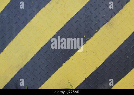 Black and yellow danger warning sign. Attention - Stock Photo