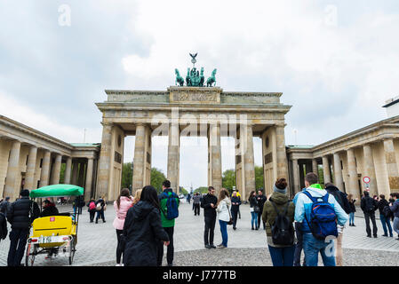 Berlin, Germany - April 12, 2017: Brandenburg gate full of tourists in Berlin, Germany - Stock Photo