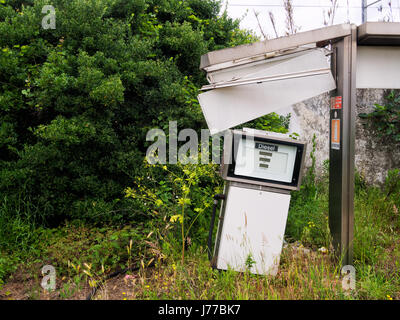 Roof fallen in on old disused diesel pump. - Stock Photo