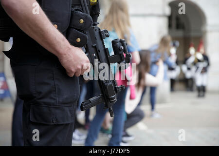 London, UK. 23rd May, 2017. An Armed policeman is pictured after Manchester Arena bombing, in London, UK, on May - Stock Photo