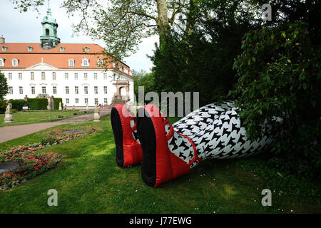 Niederwiesa, Germany. 23rd May, 2017. Picture of a pair of giant inflatable female legs as advertisement for the - Stock Photo