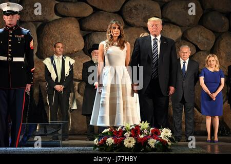 U.S. President Donald Trump and First Lady Melania Trump stand for a moment of silence during a wreath ceremony - Stock Photo