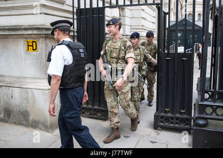 London, UK. 24th May, 2017. Operation Temperer: Soldiers leave Downing Street to patrol with police. Credit: Mark - Stock Photo