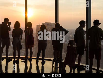 HO CHI MINH CITY, VIETNAM - APRIL 15: Tourists enjoy the view from an observatory in a tall building in Ho Chi Minh - Stock Photo