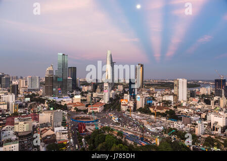 HO CHI MINH CITY, VIETNAM: The sun sets over the Ho Chi Minh City skyline that mix the colonial and business district - Stock Photo