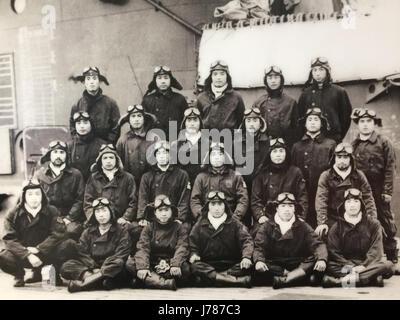 PEARL HARBOUR Lieutenant Masao Sato's fighter unit pose on the Japanese aircraft carrier Zuikaku's flight deck, - Stock Photo