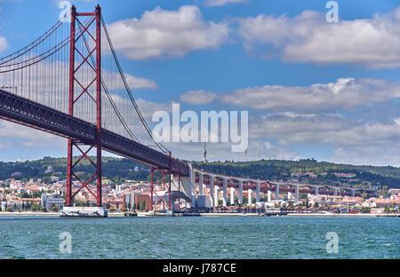 The 25 de Abril Bridge Ponte 25 de Abril, 25th of April Bridge, is a suspension bridge connecting the city of Lisbon - Stock Photo