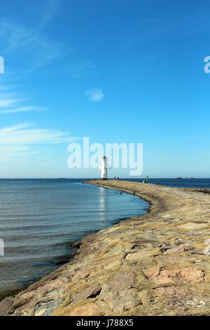 Lighthouse windmill and Baltic Sea in Swinoujscie, Poland - Stock Photo