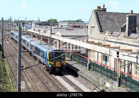 Siemens Desiro class 350 electric multiple unit, number 350404, passing through Carnforth on the WCML with a Manchester - Stock Photo