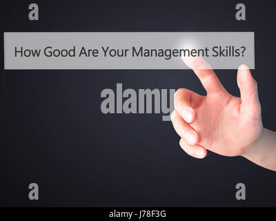 How Good Are Your Management Skills - Hand pressing a button on blurred background concept . Business, technology, - Stock Photo