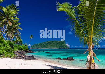 Panorama of vibrant tropical Lalomanu beach on Samoa Island with coconut palm trees - Stock Photo