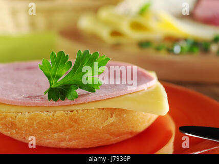 bread roll kaiser sandwich occupied food breakfeast breakfast bread green brown - Stock Photo