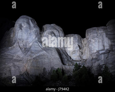 Faces at night, Mount Rushmore National Memorial, South Dakota. - Stock Photo