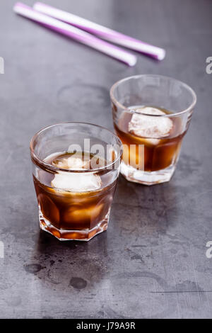 Cold brew coffee on rustic gray table, simple summer iced drink - Stock Photo