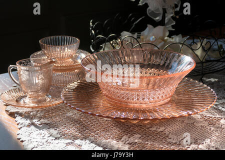 Decorative Glass Bowl, Plate and Creamer Radiating Sunlight on Oak Table - Stock Photo