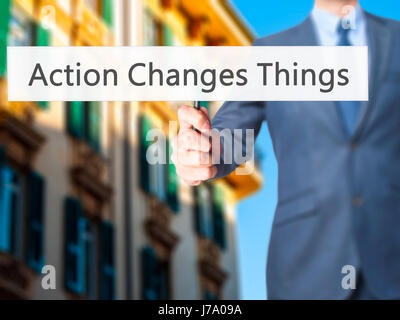 Action Changes Things - Business man showing sign. Business, technology, internet concept. Stock Photo - Stock Photo