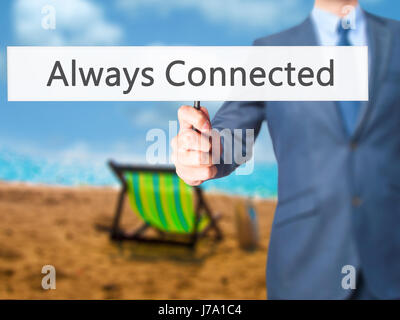Always Connected - Businessman hand holding sign. Business, technology, internet concept. Stock Photo - Stock Photo