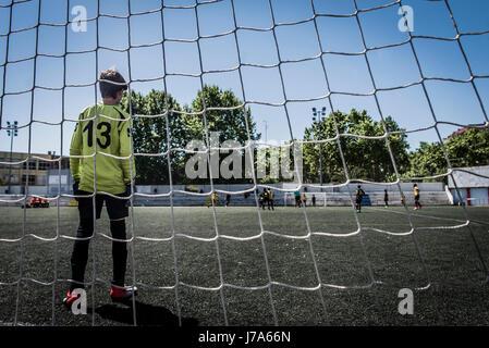 Boy as soccer goalkeeper - Stock Photo