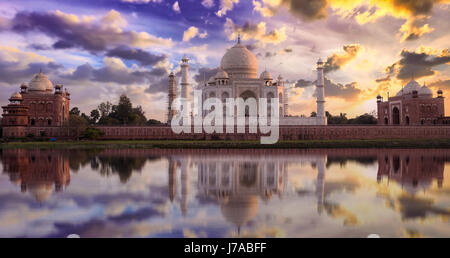 Taj Mahal sunset view from Mehtab Bagh on the banks of Yamuna river. Taj Mahal is a white marble mausoleum designated - Stock Photo