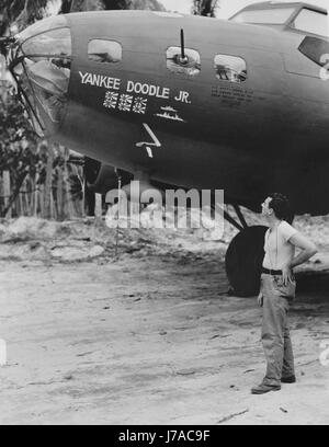 American soldier admiring the B-17 Flying Fortress, circa 1942. - Stock Photo