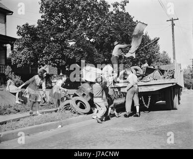 Youngsters help load a truck with scrap metal for donation to their war industries, 1942. - Stock Photo