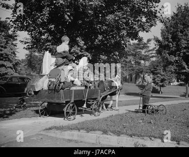 Youngsters collecting scrap on a pony cart for donation to their war industries, 1942. - Stock Photo