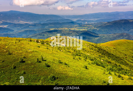 mountain summer landscape. meadow with huge rocks among the grass on top of the hillside near the peak of mountain - Stock Photo
