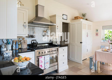 Spacious Open Plan Kitchen With Smeg Range Cooker And Rustic Floor Tiles,  The Units Are