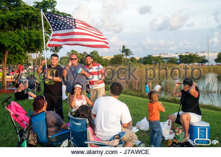 Miami Florida Doral J. C. Bermudez Park Fourth 4th of July celebration Hispanic family families flag man woman women - Stock Photo