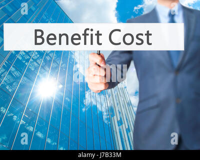 Benefit Cost - Businessman hand holding sign. Business, technology, internet concept. Stock Photo - Stock Photo