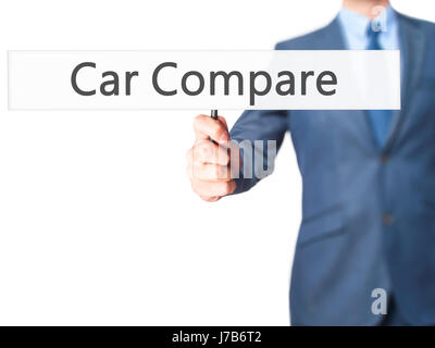 Car Compare - Business man showing sign. Business, technology, internet concept. Stock Photo - Stock Photo