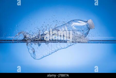 Water Bottle Splashing In Water - Stock Photo