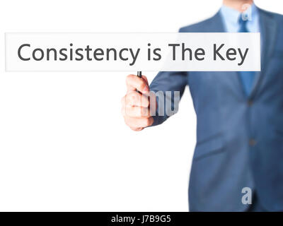 Consistency is The Key - Business man showing sign. Business, technology, internet concept. Stock Photo