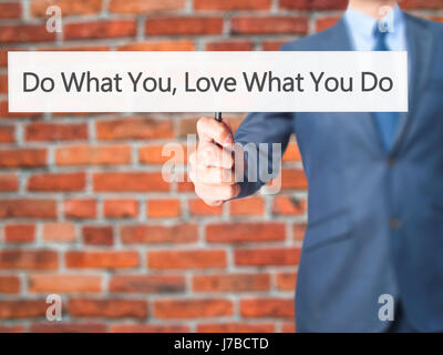 Do What You Love What You Do - Businessman hand holding sign. Business, technology, internet concept. Stock Photo - Stock Photo